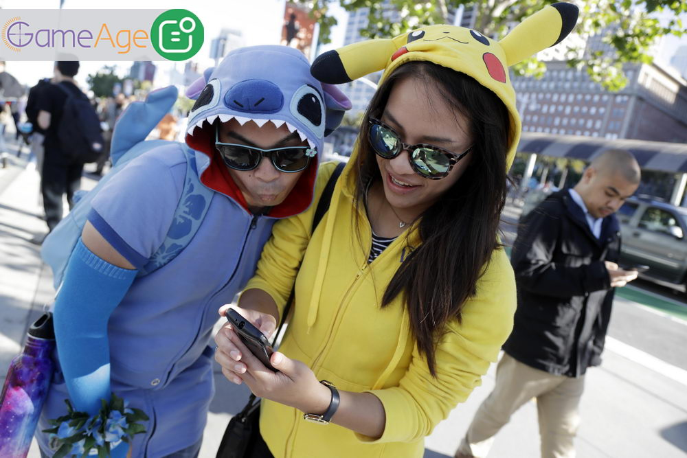 People costumed as the game's characters participate in a Pokemon Go search during a gathering of players Wednesday, July 20, 2016, in San Francisco. (AP Photo/Marcio Jose Sanchez)